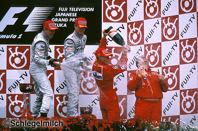 Schumacher and McLaren drivers on podium