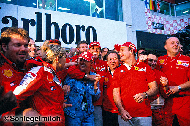 Schumacher with wife and team