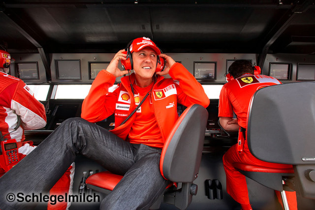 Michael Schumacher on pit wall