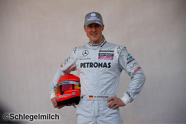 Michael Schumacher in Mercedes driving suit with helmet