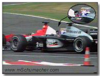 Coulthard makes hand motion to Schumacher