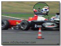 Coulthard shows finger to Schumacher